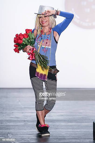 Designer Betsey Johnson walks the runway during the Betsey Johnson 50th Anniversary fashion show at The Arc Skylight at Moynihan Station on September...