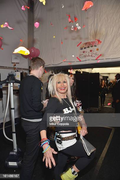 Designer Betsey Johnsonposes for a photo backstage at the Betsey Johnson Fall 2013 fashion show during MercedesBenz Fashion Week at The Studio at...