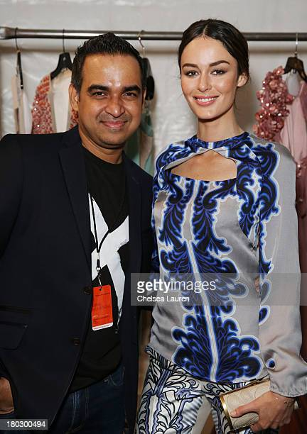Designer Bibhu Mohapatra and model Nicole Trunfio pose backstage at the Bibhu Mohapatra fashion show during MercedesBenz Fashion Week Spring 2014 at...