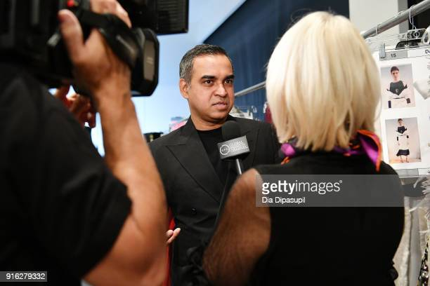 Designer Bibhu Mohapatra poses backstage for Bibhu Mohapatra during New York Fashion Week The Shows at Gallery II at Spring Studios on February 9...