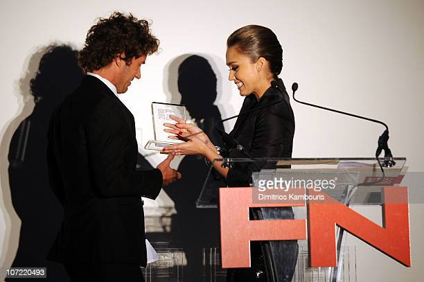 Designer Blake Mycoskie accepts an award from actress Jessica Alba onstage at Footwear News 24th Annual Achievement Awards at The Museum of Modern...