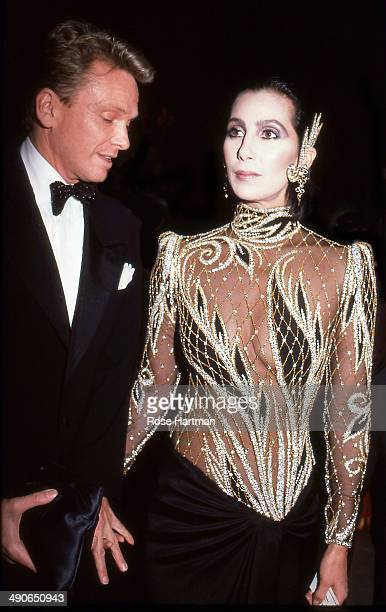 Designer Bob Mackie and the singer and actress Cher attend the Costume Institute Gala at the Metropolitan Museum of Art New York New York 1985