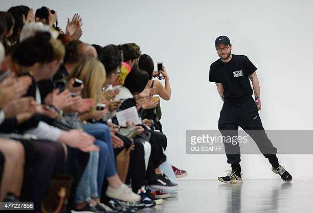 Designer Bobby Abley acknowledges the applause following a fashion show of his creations on the fourth day of the Spring/Summer 2016 London...