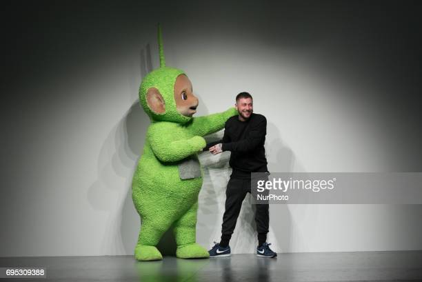Designer Bobby Abley poses with a Teletubby on the runway at the Bobby Abley show during the London Fashion Week Men's June 2017 collections on June...