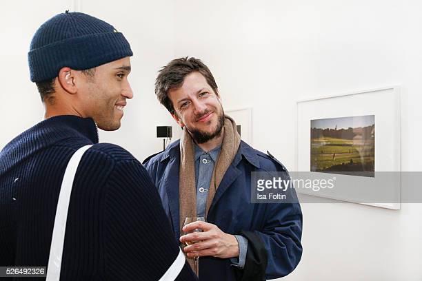 Designer Bobby Kolade and designer Michael Sonntag at 'Der Berliner Fotografie Salon Edition 1' on April 29 2016 in Berlin Germany
