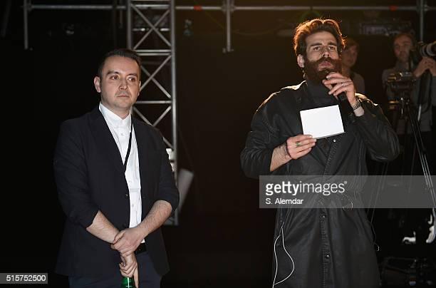 Designer Bora Aksu and Uhurhan Akdeniz are seen backstage ahead of the Bora Aksu show during the Mercedes-Benz Fashion Week Istanbul Autumn/Winter...
