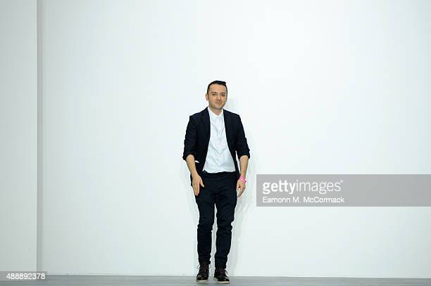Designer Bora Aksu appears at the end of the runway following the Bora Aksu show during London Fashion Week Spring/Summer 2016 on September 18, 2015...