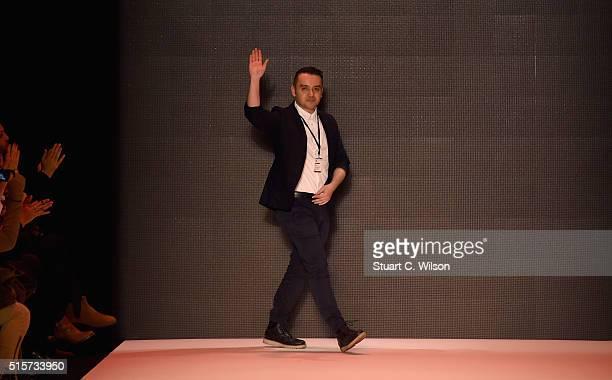 Designer Bora Aksu attends his runway show during the Mercedes-Benz Fashion Week Istanbul Autumn/Winter 2016 at Zorlu Center on March 15, 2016 in...