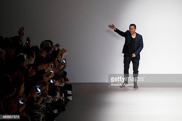 Designer Bora Aksu salutes the audiences on the runway at the his show show during London Fashion Week Fall/Winter 2015/16 at Somerset House on...
