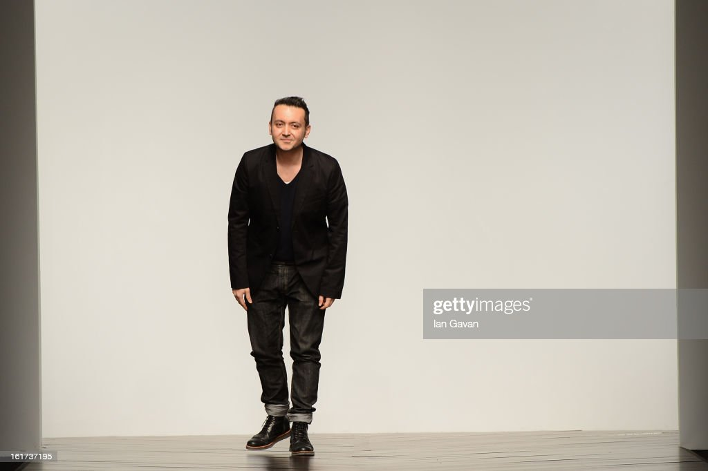 Designer Bora Aksu walks the runway at the Bora Aksu show during London Fashion Week Fall/Winter 2013/14 at Somerset House on February 15, 2013 in London, England.