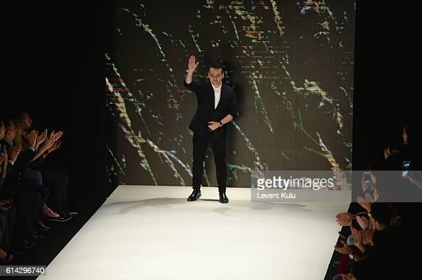 Designer Bora Aksu walks the runway at the Bora Aksu show during Mercedes-Benz Fashion Week Istanbul at Zorlu Center on October 13, 2016 in Istanbul,...
