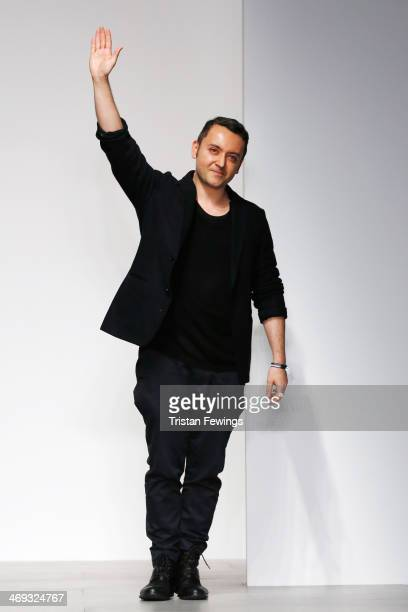 Designer Bora Aksu waves to crowd on the runway at the Bora Aksu show at London Fashion Week AW14 at Somerset House on February 14, 2014 in London,...
