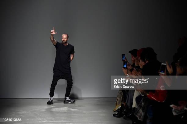 Designer Boris Bidjan Saberi acknowledges the audience during the Boris Bidjan Saberi Menswear Fall/Winter 20192020 show as part of Paris Fashion...