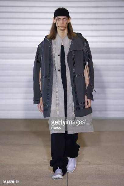 Designer Boris Bidjan Saberi walks the runway during the Boris Bidjan Saberi Menswear Spring/Summer 2019 show as part of Paris Fashion Week on June...