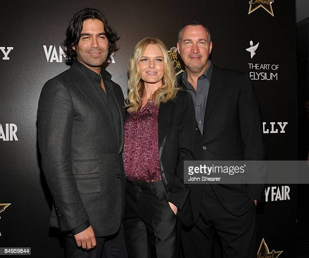 Designer Brian Atwood, actress Kate Bosworth, and Vanity Fair publisher Edward Menicheschi arrive at the Bally and Vanity Fair Hollywood Domino Game...