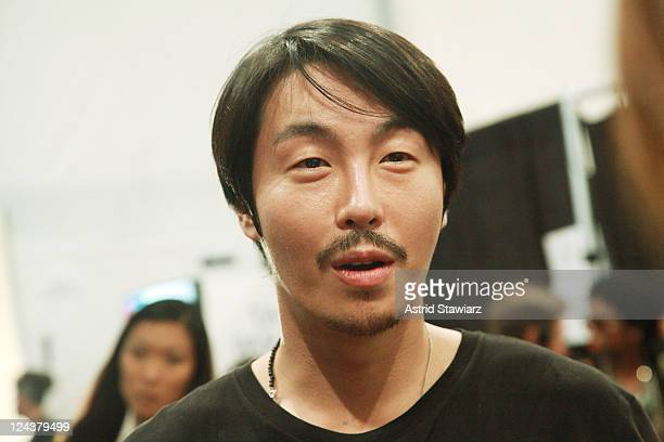 Designer Bumsuk Choi poses backstage at the General Idea Spring 2012 fashion show during MercedesBenz Fashion Week at The Studio at Lincoln Center on...