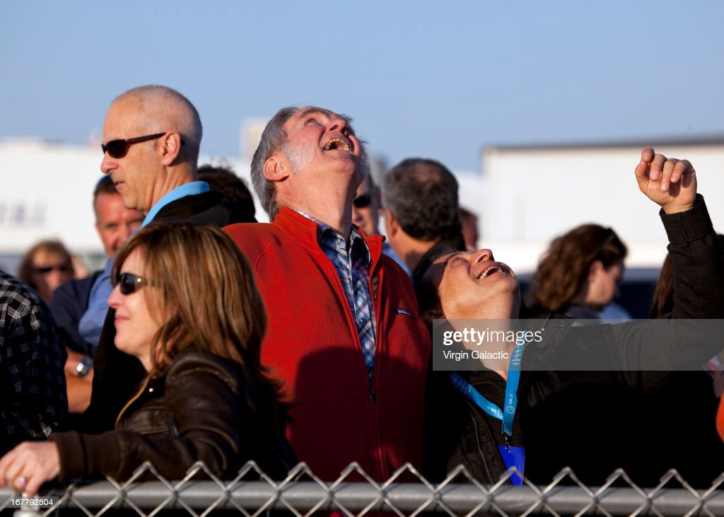 Designer Burt Rutan shares his joy watching SS2 powered flight next to X-Prize founder Peter Diamandis during the first powered flight of Virgin Galactic's SpaceShipTwo on April 29, 2013 in Mojave, California. SpaceShipTwo is a private enterprise aircraft, designed to carry paying passengers into space. The spacecraft was dropped from the mothership at high altitude and fired it's engine for a approximate 16-second burn taking the craft through the sound barrier. The hybrid rocket motor is fueled by nitrous oxide and a rubber propellent combination. The motor can be 'shut down' at any time for safety and flight requirement purposes.