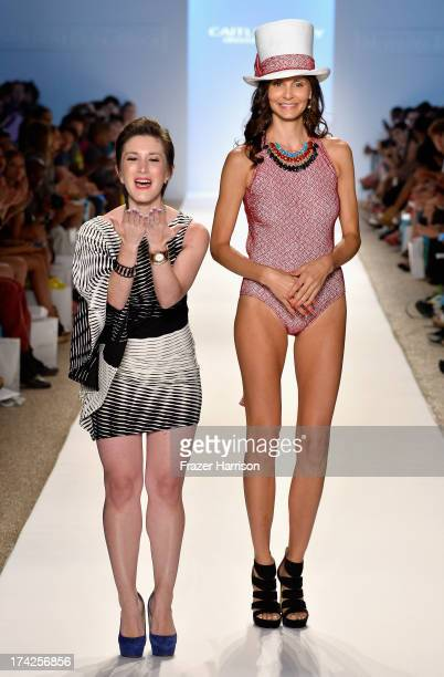 Designer Caitlin Kelly and a model walk the runway at the Caitlin Kelly Swimwear show at Cabana Grande at the Raleigh on July 22 2013 in Miami Florida