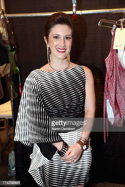 Designer Caitlin Kelly poses backstage at the AChe Swimwear/Aguaclara Swimwear/Aquarella Swimwear/Caitlin Kelly Swimwear show during MercedesBenz...