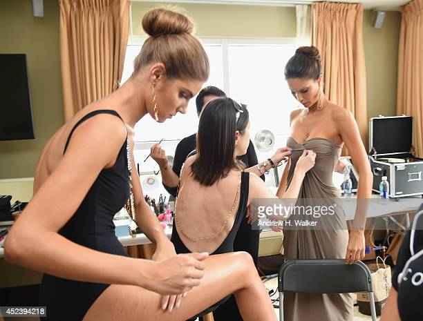 Designer Caitlin Kelly with models backstage during MercedesBenz Fashion Week Swim 2015 at The Raleigh on July 19 2014 in Miami Beach Florida
