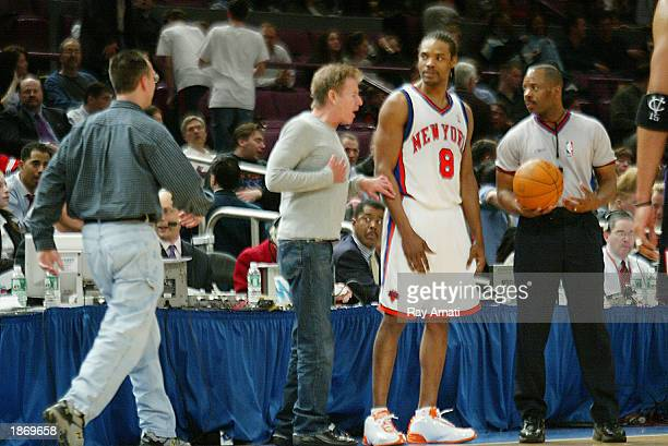 Designer Calvin Klein approaches Latrell Sprewell of the New York Knicks during a fourth quarter time out of the Toronto Raptors against the New York...