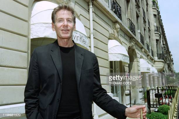 US designer Calvin Klein poses for photographers on May 14 1997 on Avenue Montaigne after the inauguration of his first shop in Paris