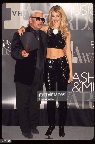 Designer Carl Lagerfeld stands next to model Claudia Schiffer at the 1995 VH1 Fashion and Music Awards December 3 1995 in New York City The awards...