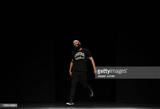 Designer Carlos Diez greets the crowd at the end of the Martin Lamothe Carlos Diez fashion show during the Cibeles Madrid Fashion Week Autumn/Winter...