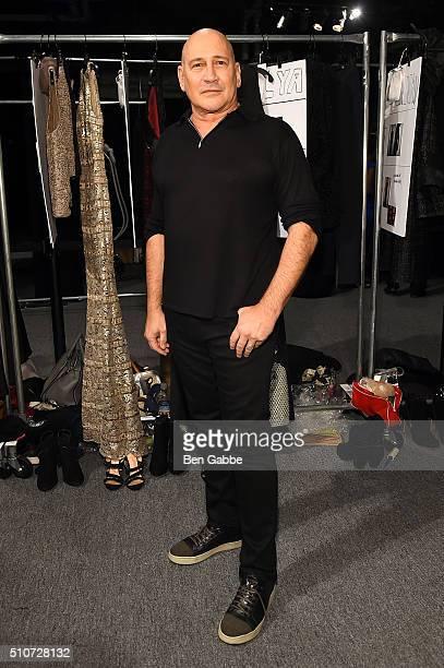 Designer Carmen Marc Valvo poses backstage at Carmen Marc Valvo F/W 2016 at The Arc Skylight at Moynihan Station on February 16 2016 in New York City