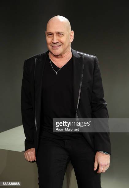 Designer Carmen Marc Valvo poses backstage at his presentation during New York Fashion Week on February 14 2017 in New York City