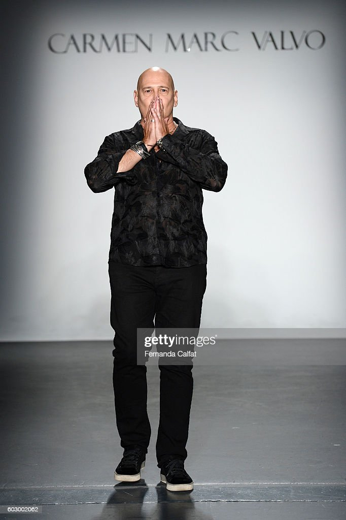 Designer Carmen Marc Valvo poses on the runway at the Carmen Marc Valvo Spring/Summer 2017 Fashion Show during New York Fashion Week at Pier 59 Studios on September 11, 2016 in New York City.