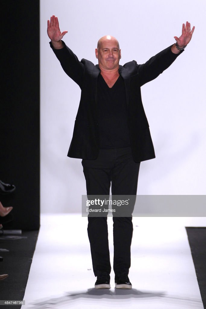Designer Carmen Marc Valvo walks the runway at Carmen Marc Valvo during Mercedes-Benz Fashion Week Spring 2015 at The Theatre at Lincoln Center on September 5, 2014 in New York City.