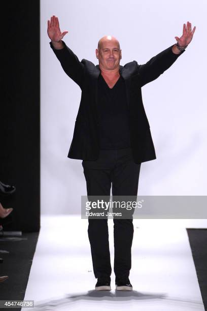 Designer Carmen Marc Valvo walks the runway at Carmen Marc Valvo during Mercedes-Benz Fashion Week Spring 2015 at The Theatre at Lincoln Center on...