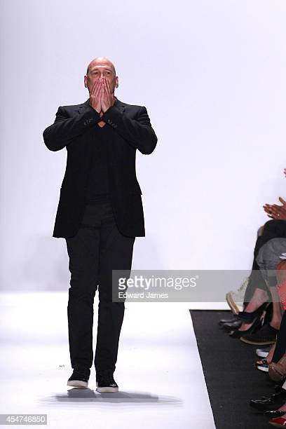 Designer Carmen Marc Valvo walks the runway at Carmen Marc Valvo during MercedesBenz Fashion Week Spring 2015 at The Theatre at Lincoln Center on...