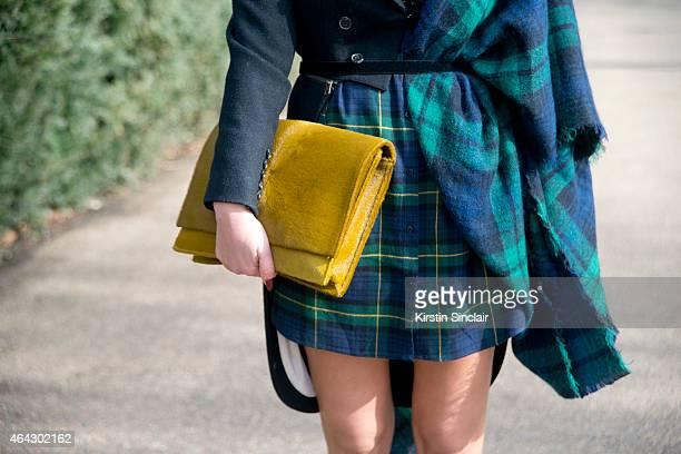 Designer Carmen Negoita wears Yvy bag Alexander McQueen jacket and Zara dress and scarf on February 23 2015 in London England