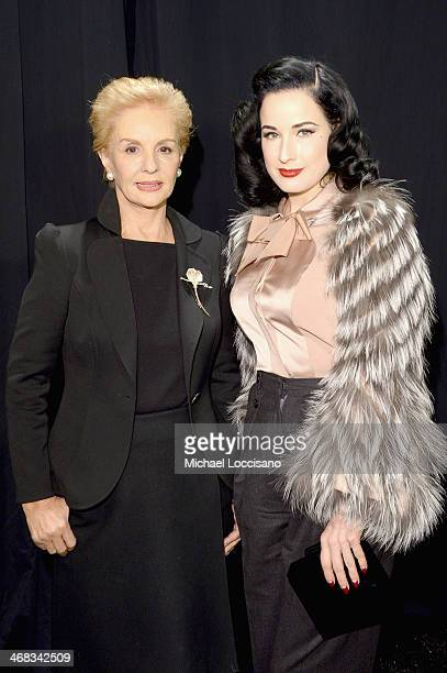 Designer Carolina Herrera and Dita Von Teese backstage at the Carolina Herrera fashion show during MercedesBenz Fashion Week Fall 2014 at The Theatre...