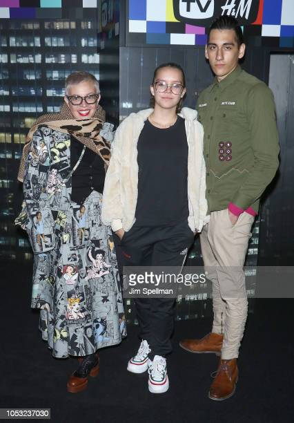 Designer Catherine Martin Lillian Amanda Luhrmann and William Alexander Luhrmann attend the Moschino x HM show at Pier 36 on October 24 2018 in New...