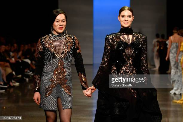 Designer Cecilia Kang thanks the audience following the Cecilia Kang Couture runway during the New Generation Emerging Couture show during New...