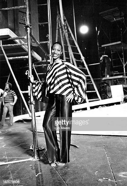 APR 21 1980 APR 22 1980 APR 27 1980 Designer Celestine Bryant models Quina satin top of yellow red purple orange green stripes with butterfly sleeves...