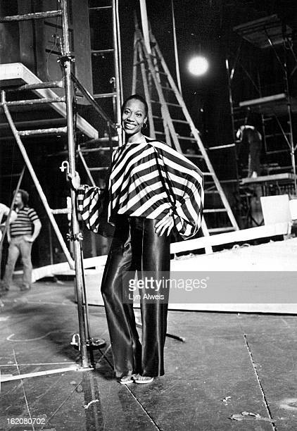 APR 21 1980 APR 22 1980 AJPR 27 1980 Designer Celestine Bryant models Quina Satin top of yellow red purple orange green stripes with butterfly...
