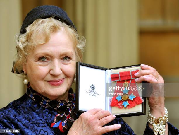 Designer Celia Birtwell poses after she was awarded a CBE for her services to the fashion industry by Queen Elizabeth II during an Investiture...