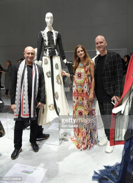 Designer Charles Borg Founder Creative Director of EcoAge Livia Firth and Designer Ron van Maarschalkerweerd attend The EcoAge Commonwealth Fashion...