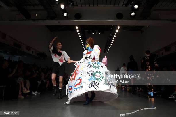 Designer Charles Jeffrey and models salute the crowd after the Charles Jeffrey LOVERBOY show during the London Fashion Week Men's June 2017...
