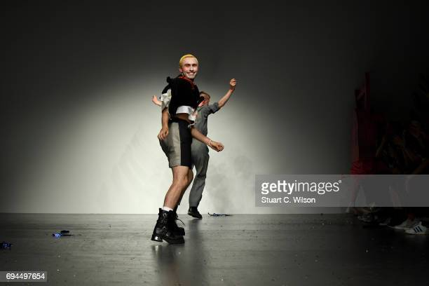 Designer Charles Jeffrey salutes the crowd after the Charles Jeffrey LOVERBOY show during the London Fashion Week Men's June 2017 collections on June...