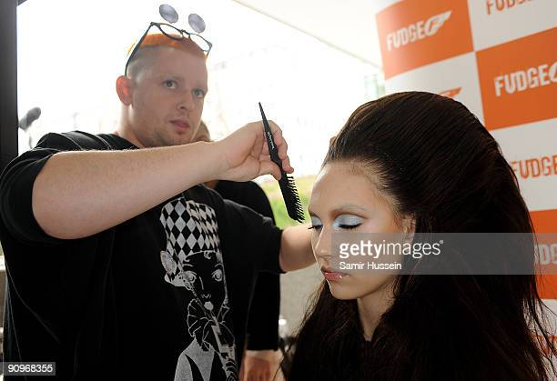 Designer Charlie Le Mindu prepares a model backstage ahead of the Charlie Le Mindu Spring/Summer 2010 show as part of Blow Presents during London...
