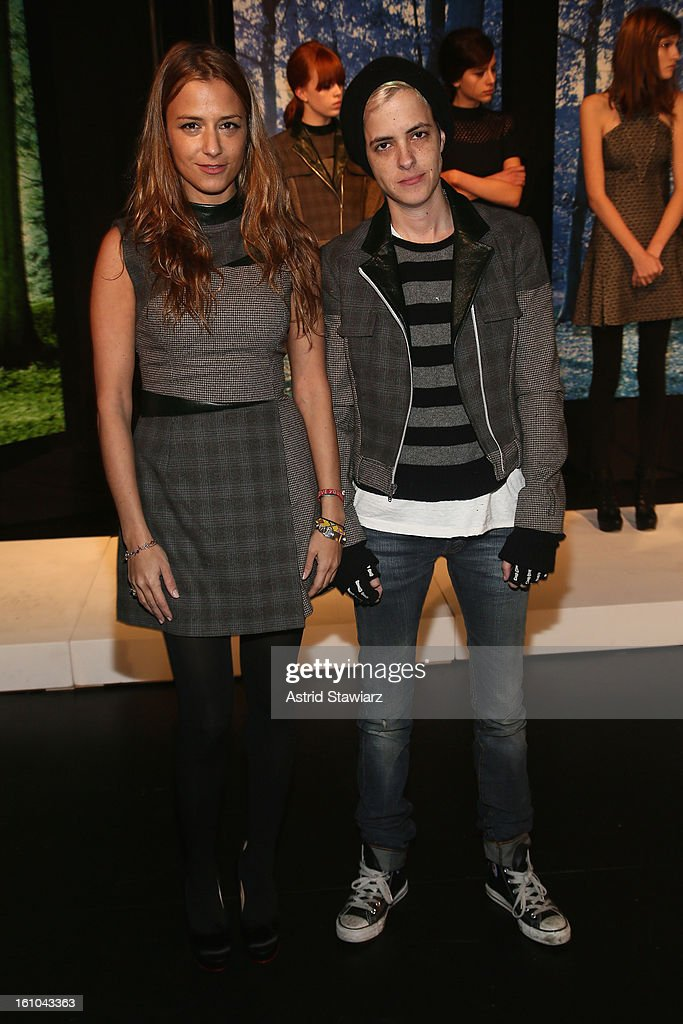 Designer Charlotte Ronson (L) and DJ Samantha Ronson pose on the runway at the Charlotte Ronson Fall 2013 Presentation during Mercedes-Benz Fashion Week at The Box at Lincoln Center on February 8, 2013 in New York City.