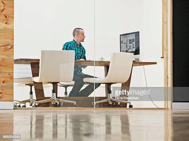 Designer checks presentation in meeting room