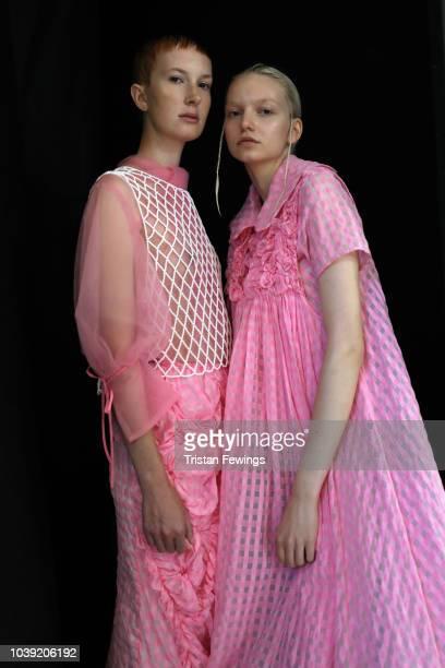 Designer Chika Kisada jokes with models backstage ahead of the Chika Kisada show during Milan Fashion Week Spring/Summer 2019 on September 24 2018 in...