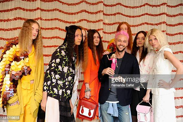 Designer Chris Benz poses with models at the Chris Benz Spring 2013 presentation during MercedesBenz Fashion Week at Avery Fisher Hall Lincoln Center...