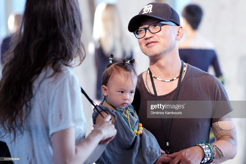 Designer Chris Leba (R is interviewed backstage at the R13 Show during New York Fashion Week on September 8, 2018 in New York City.